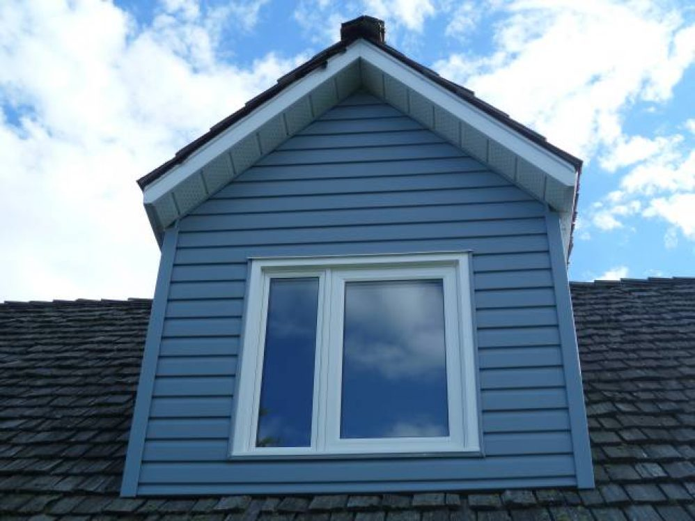 window replacement at the top of a home